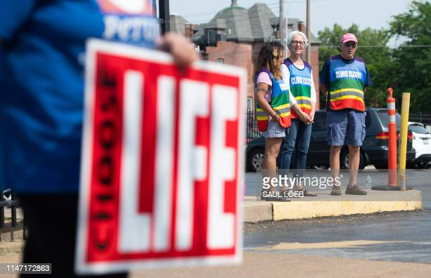 Clinic escorts stand in the parking lot as antiabortion demonstrators hold a protest outside the Planned Parenthood Reproductive Health Services...