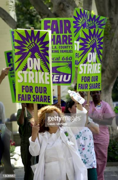 Clinic nurse attendant Lupe JamaFuentes and other striking Los Angeles County employees picket outside of LA CountyUniversity of Southern California...