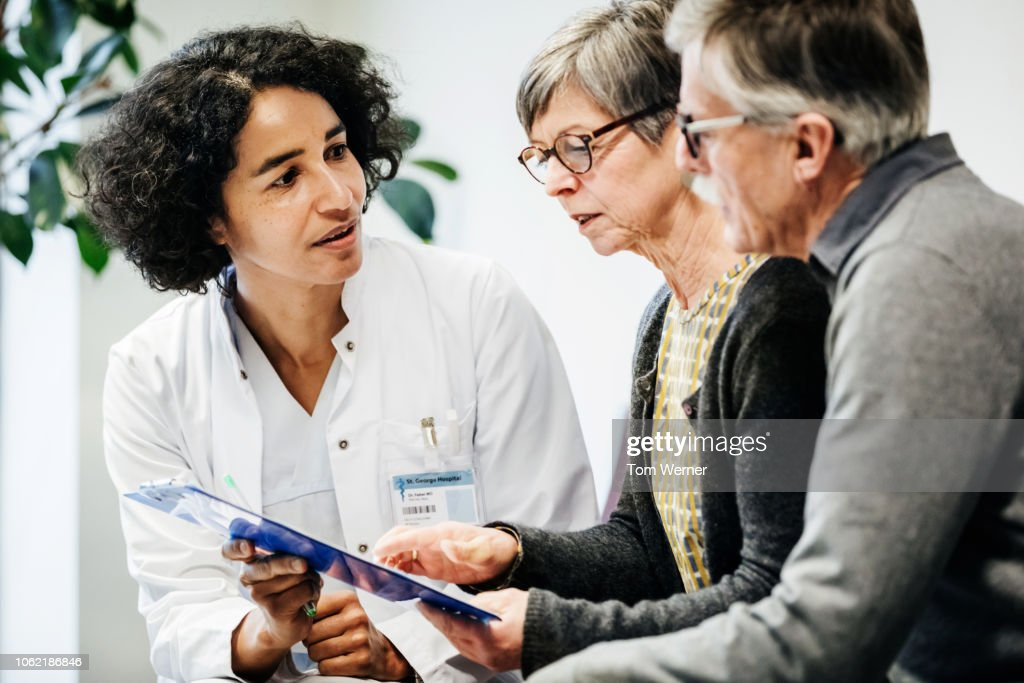 Clinical Doctor Giving Test Results To Patients : Stock Photo