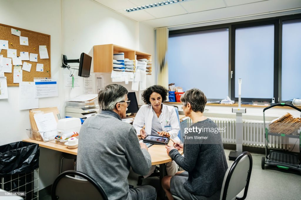 Clinical Doctor Talking To Patients : Stock Photo