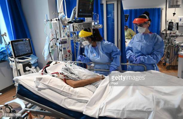 Clinical staff wear Personal Protective Equipment as they care for a patient at the Intensive Care unit at Royal Papworth Hospital on May 5, 2020 in...
