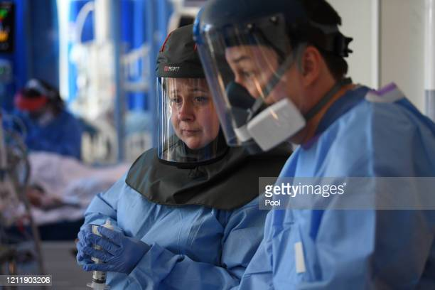 Clinical staff wear Personal Protective Equipment as they care for a patient the Intensive Care unit at Royal Papworth Hospital on May 5 2020 in...