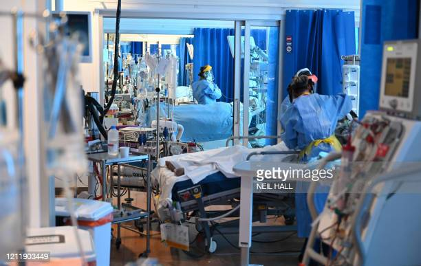 Clinical staff wear personal protective equipment as they care for patients at the Intensive Care unit at Royal Papworth Hospital in Cambridge on May...