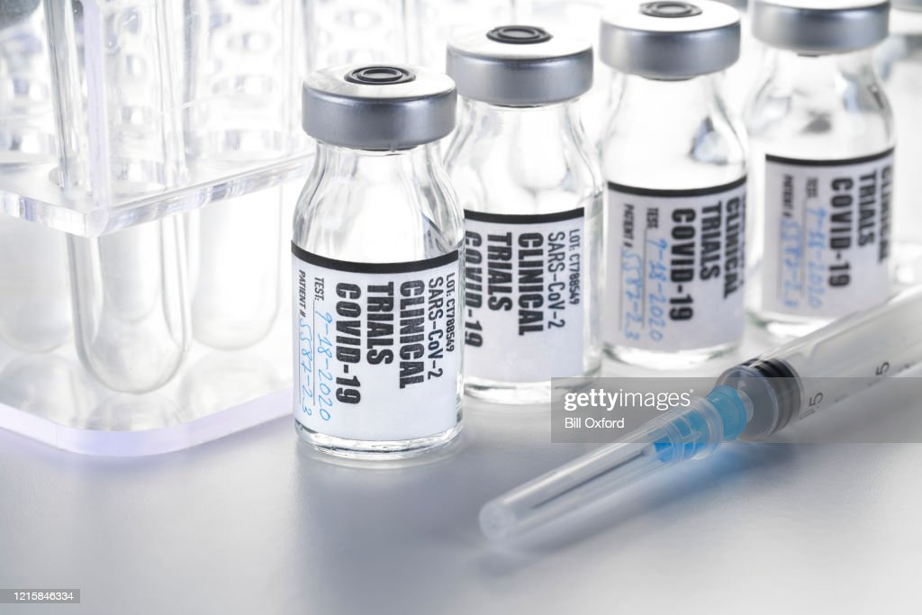 Clinical Trial - Vaccine: Covid-19, Coronavirus in vial with syringe on white background : Stock Photo