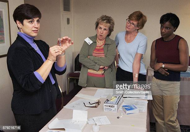 CDC Clinician Joanne Cono MD describes the diluent syringe for smallpox vaccine during the 2002 Vaccinator Workshop 2002 In December 2002 CDC...