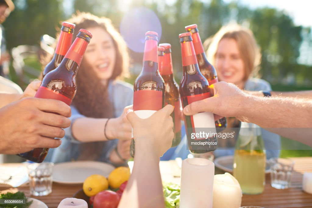 Clinking beer bottles : Stock Photo