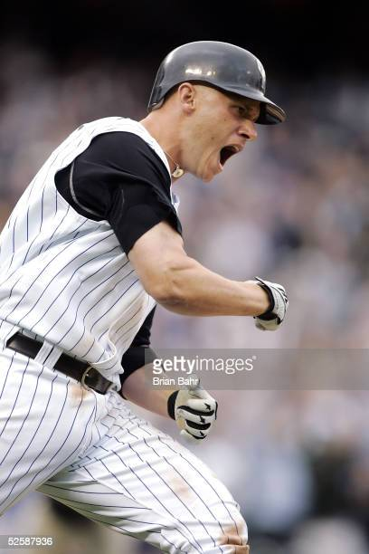 Clint Barmes of the Colorado Rockies pumps his fist in celebration after hitting the walkoff gamewinning home run against the San Diego Padres in the...