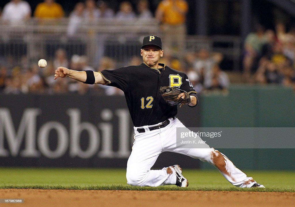 Clint Barmes #12 of the Pittsburgh Pirates makes a late throw to first base from his knee in the sixth inning against the Washington Nationals during the game on May 3, 2013 at PNC Park in Pittsburgh, Pennsylvania.