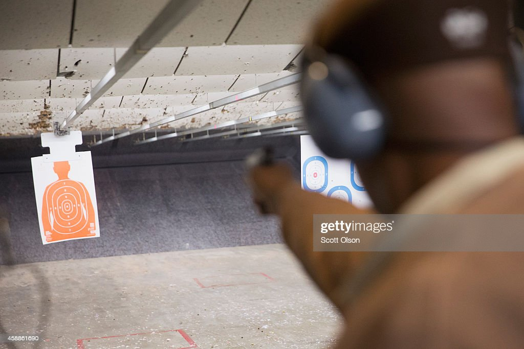 Clint Billups practices his marksmanship skills at the Metro Shooting Supplies range on November 12, 2014 in Bridgeton, Missouri. The suburban St. Louis store is located near Ferguson, Missouri where several weeks of sometimes violent protests erupted following the shooting death of Michael Brown by Ferguson police officer Darren Wilson on August 9th. The gun shop last week experienced a 300 percent increase in sales over the same period last year. About 60 percent of those sales are from first-time gun owners. The increase is attributed in part to concern from residents of additional outbreaks of violence if the grand jury investigating Brown's death does not find justification to prosecute Wilson for the shooting. The grand jurys decision is expected sometime in November.