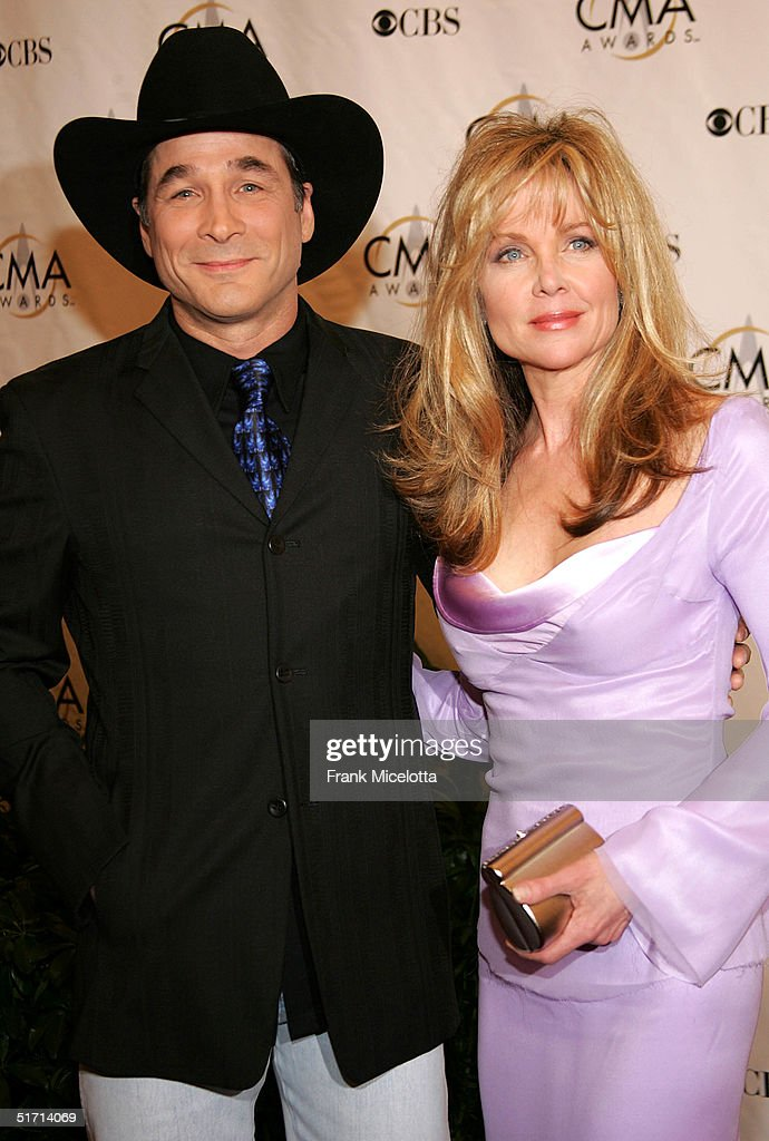 Clint Black & Lisa Hartman Black arrive at the 38th Annual CMA Awards at the Grand Ole Opry House November 9, 2004 in Nashville, Tennessee.