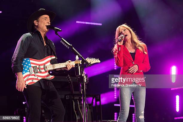 Clint Black performs with wife Lisa Hartman Black during the CMA Festival at Nissan Stadium on June 10 2016 in Nashville Tennessee