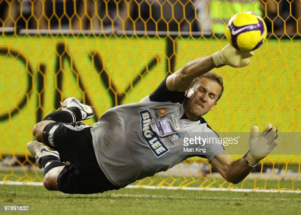 Clint Bolton of Sydney saves the penalty shootout attempt of Marvin Angulo of the Victory during the ALeague Grand Final match between the Melbourne...