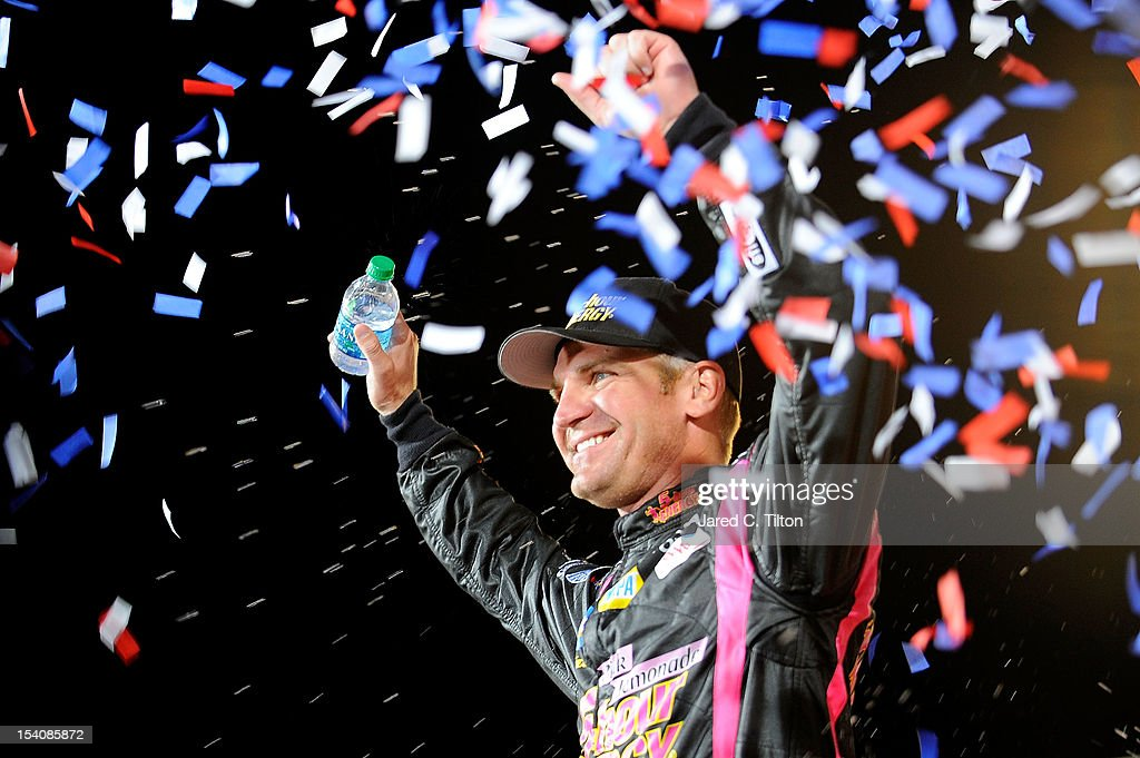 Clint Bowyer, driver of the #15 5-Hour Energy Benefiting Avon Foundation for Women Toyota, celebrates in Victory Lane after winning the NASCAR Sprint Cup Series Bank of America 500 at Charlotte Motor Speedway in Concord, North Carolina.