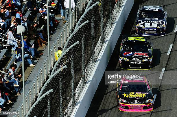 Clint Bowyer driver of the 5Hour Energy Benefiting Avon Foundation for Women Toyota leads Jeff Gordon driver of the Pepsi Max Chevrolet and Jimmie...
