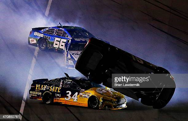 Clint Bowyer driver of the 5hour ENERGY Toyota and David Ragan driver of the CSX Play It Safe Ford are involved in an incident during the NASCAR...