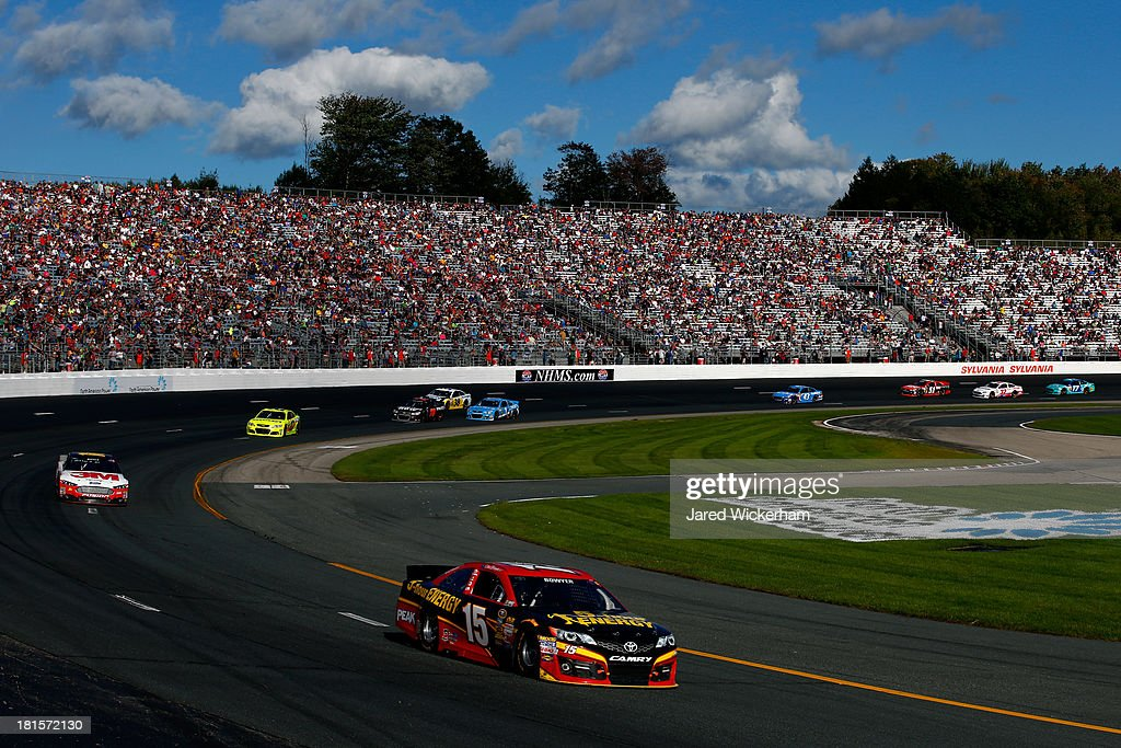 Clint Bowyer, driver of the #15 5-hour ENERGY Toyota, leads Greg Biffle, driver of the #16 3M Ford, during the NASCAR Sprint Cup Series Sylvania 300 at New Hampshire Motor Speedway on September 22, 2013 in Loudon, New Hampshire.