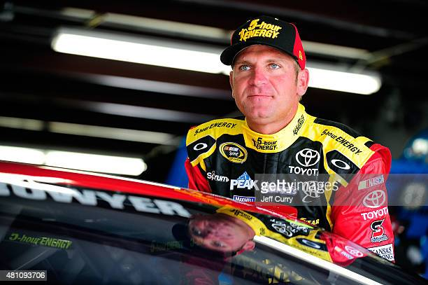 Clint Bowyer driver of the 5Hour Energy Toyota stands in the garage area during practice for the NASCAR Sprint Cup Series 5Hour Energy 301 at New...
