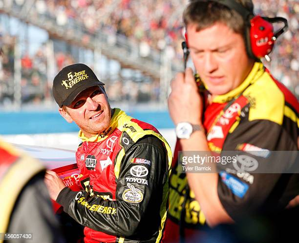 Clint Bowyer driver of the 5hour Energy Toyota talks with crew chief Brian Pattie R0 on pit road after an incident with Jeff Gordon driver of the...
