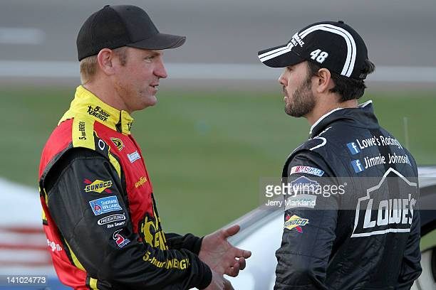 Clint Bowyer driver of the 5hour Energy Toyota talks with Jimmie Johnson driver of the Lowe's/Kobalt Tools Chevrolet during qualifying for the NASCAR...