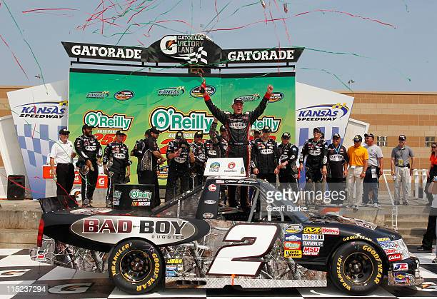Clint Bowyer driver of the Bad Boy Buggies Chevrolet celebrates in Victory Lane after winning the NASCAR Camping World Truck Series O'Reilly Auto...