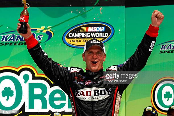 Clint Bowyer, driver of the Bad Boy Buggies Chevrolet, celebrates in Victory Lane after winning the NASCAR Camping World Truck Series O'Reilly Auto...