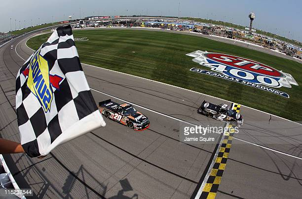 Clint Bowyer driver of the Bad Boy Buggies Chevrolet crosses the finish line to win the NASCAR Camping World Truck Series O'Reilly Auto Parts 250 at...
