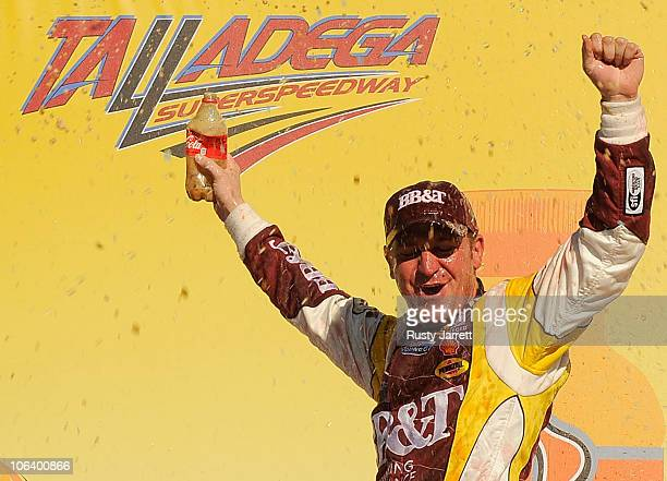 Clint Bowyer driver of the BBT Chevrolet celebrates in a Victory Lane after winning the NASCAR Sprint Cup Series AMP Energy Juice 500 at Talladega...