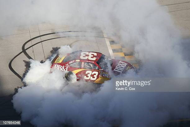 Clint Bowyer driver of the BBT Chevrolet does a burnout after winning the NASCAR Sprint Cup Series AMP Energy Juice 500 at Talladega Superspeedway on...