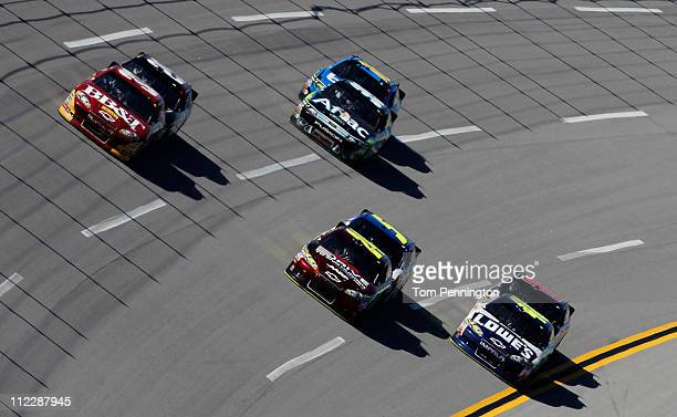 Clint Bowyer driver of the BBT Chevrolet Jeff Gordon driver of the Drive to End Hunger/AARP Chevrolet and Jimmie Johnson driver of the Lowe's...