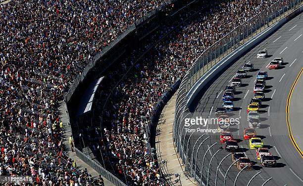 Clint Bowyer driver of the BBT Chevrolet leads the field on a restart during the NASCAR Sprint Cup Series Aaron's 499 at Talladega Superspeedway on...