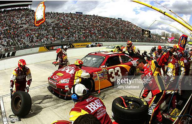 Clint Bowyer driver of the BBT Chevrolet makes a pit stop during the NASCAR Sprint Cup Series Goody's Fast Pain Relief 500 at Martinsville Speedway...