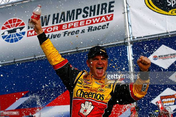 Clint Bowyer driver of the Cheerios / Hamburger Helper Chevrolet celebrates in victory lane after he won the NASCAR Sprint Cup Series Sylvania 300 at...