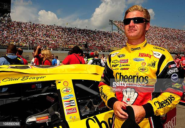 Clint Bowyer driver of the Cheerios / Hamburger Helper Chevrolet looks on from the grid during the NASCAR Sprint Cup Series CARFAX 400 at Michigan...