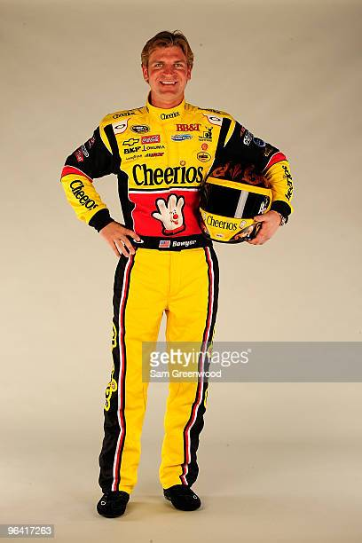 Clint Bowyer driver of the Cheerios/Hamburger Helper Chevrolet poses during NASCAR media day at Daytona International Speedway on February 4 2010 in...