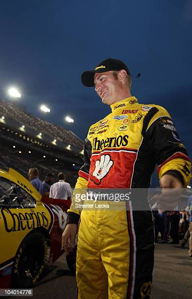 Clint Bowyer driver of the Cheerios/Hamburger Helper Chevrolet stands on the grid after making the Chase in the NASCAR Sprint Cup Series Air Guard...