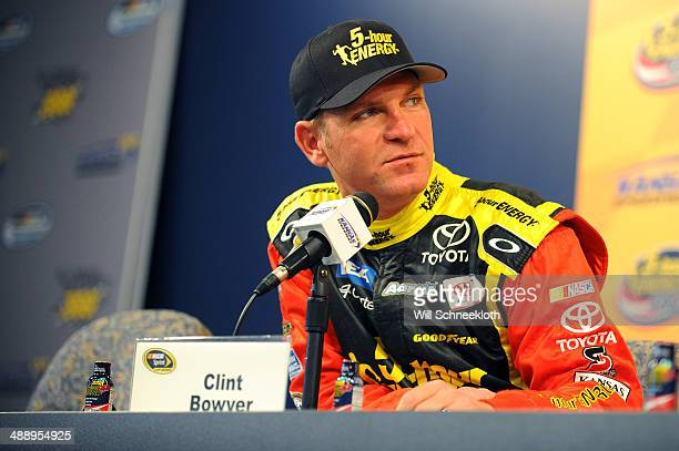 Clint Bowyer driver of the Cherry 5 hour Energy Special Operations Warrior Foundation Toyota speaks to the media prior to practice for the NASCAR...
