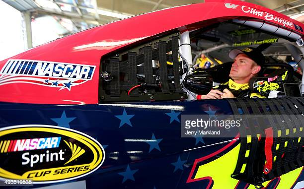 Clint Bowyer driver of the Cherry 5hour Energy for Special Operations Warrior Foundation Toyota sits in his car during practice for the NASCAR Sprint...