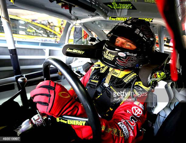 Clint Bowyer driver of the Cherry 5hour Energy for Special Operations Warrior Foundation Toyota sits in his car in the garage area during practice...