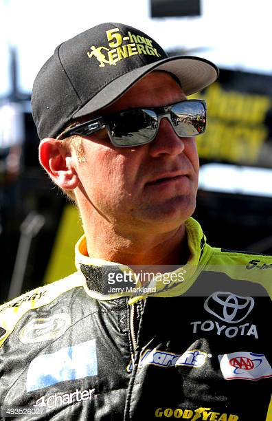 Clint Bowyer driver of the Cherry 5hour Energy for Special Operations Warrior Foundation Toyota stands in the garage area during practice for the...