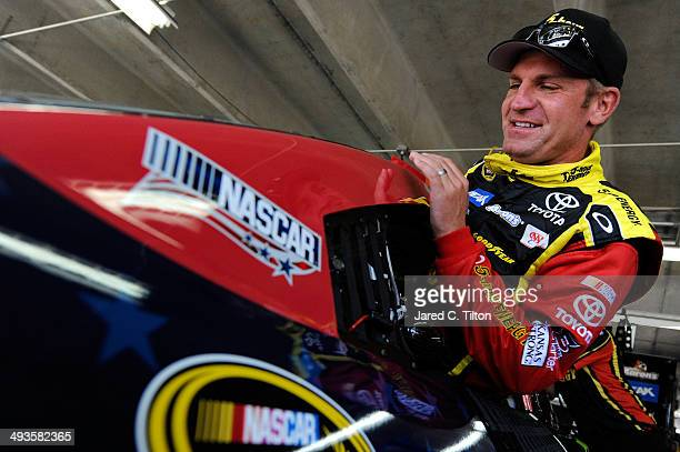 Clint Bowyer driver of the Cherry 5hour Energy for Special Operations Warrior Foundation Toyota climbs into his car during practice for the NASCAR...