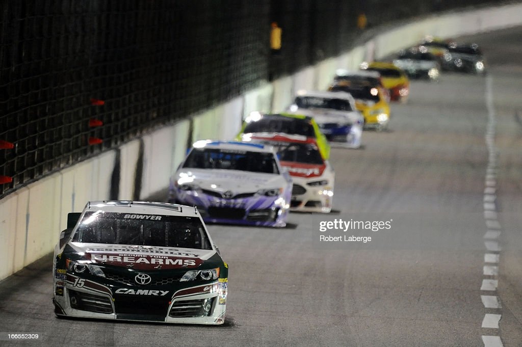 Clint Bowyer, driver of the #15 Gander Mountain Toyota, leads a group of cars during the NASCAR Sprint Cup Series NRA 500 at Texas Motor Speedway on April 13, 2013 in Fort Worth, Texas.