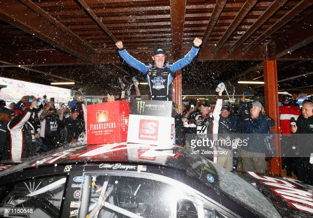 Clint Bowyer driver of the Haas 30 Years of the VF1 Ford celebrates after winning the Monster Energy NASCAR Cup Series FireKeepers Casino 400 at...