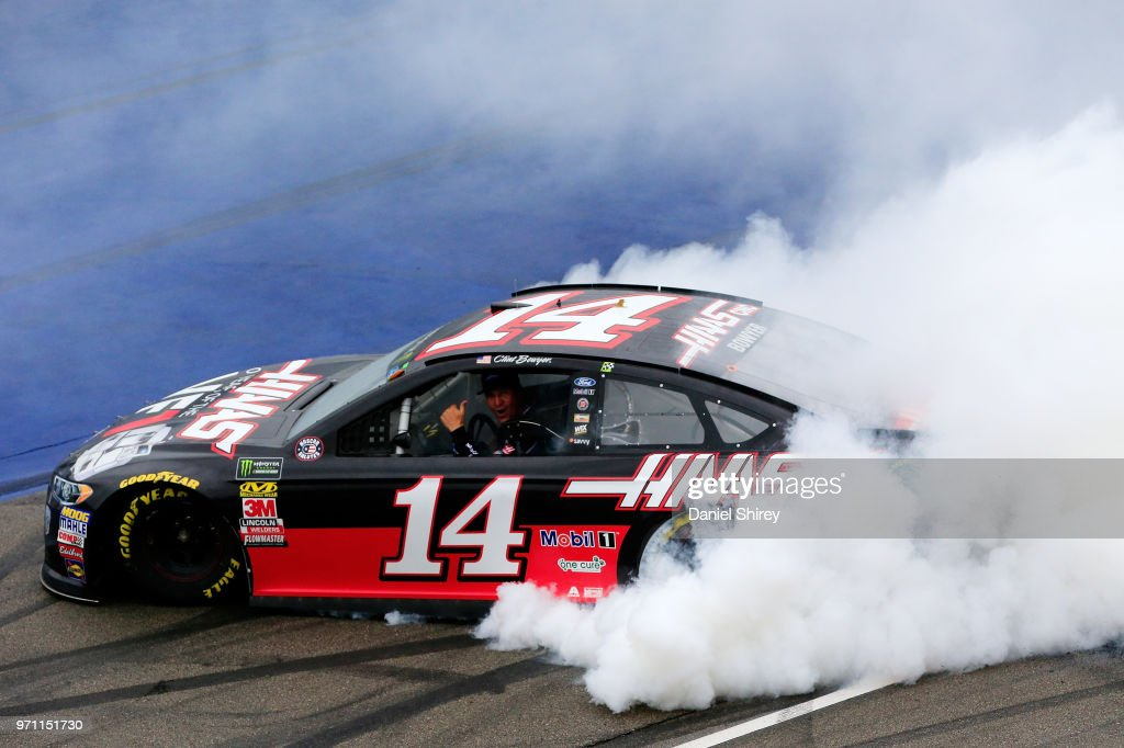 Clint Bowyer, driver of the #14 Haas 30 Years of the VF1 Ford, celebrates with a burnout after winning the Monster Energy NASCAR Cup Series FireKeepers Casino 400 at Michigan International Speedway on June 10, 2018 in Brooklyn, Michigan.