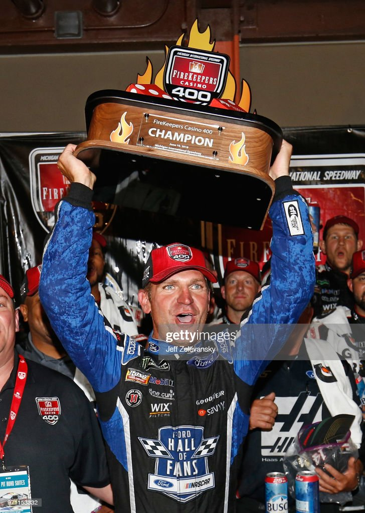 Clint Bowyer, driver of the #14 Haas 30 Years of the VF1 Ford, celebrates with the trophy after winning the Monster Energy NASCAR Cup Series FireKeepers Casino 400 at Michigan International Speedway on June 10, 2018 in Brooklyn, Michigan.
