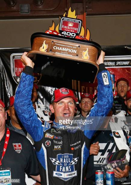 Clint Bowyer driver of the Haas 30 Years of the VF1 Ford celebrates with the trophy after winning the Monster Energy NASCAR Cup Series FireKeepers...
