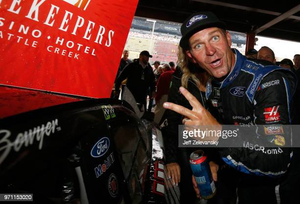 Clint Bowyer driver of the Haas 30 Years of the VF1 Ford poses with the winner's sticker after the Monster Energy NASCAR Cup Series FireKeepers...