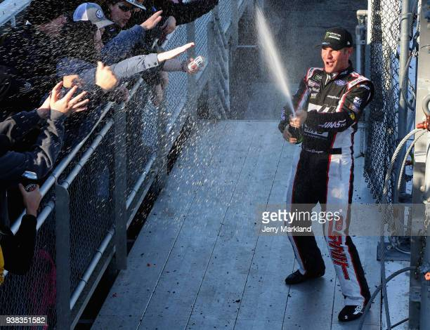 Clint Bowyer driver of the Haas Automation Demo Day Ford celebrates winning the weather delayed Monster Energy NASCAR Cup Series STP 500 at...