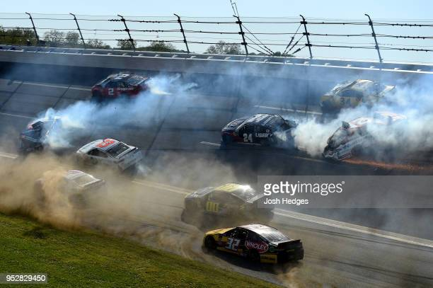 Clint Bowyer driver of the Haas Automation Demo Day Ford Denny Hamlin driver of the FedEx Express Toyota William Byron driver of the Liberty...