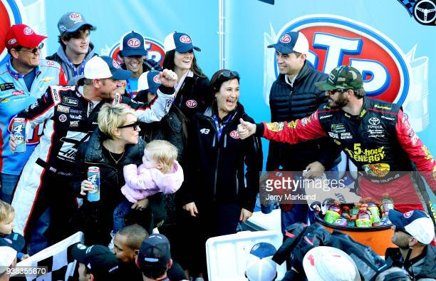 Clint Bowyer driver of the Haas Automation Demo Day Ford is congratulated in Victory Lane by Martin Truex Jr driver of the 5hour ENERGY/Bass Pro...