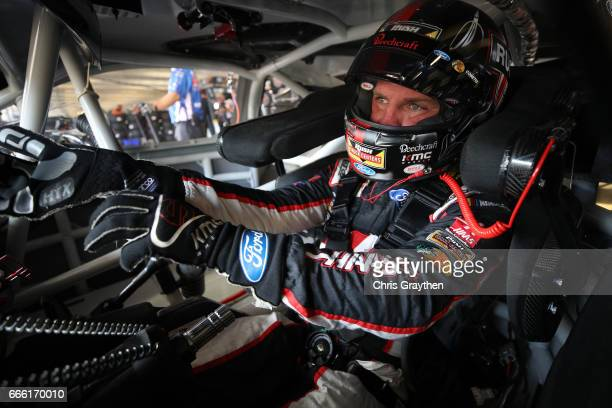 Clint Bowyer driver of the Haas Automation Ford sits in his car during practice for the Monster Energy NASCAR Cup Series O'Reilly Auto Parts 500 at...